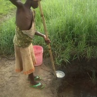 a young girl fetching water from the well