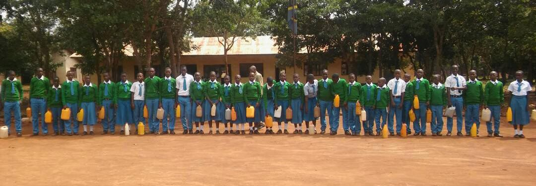 students at Kabagwe School Kigoma, with water collection cans