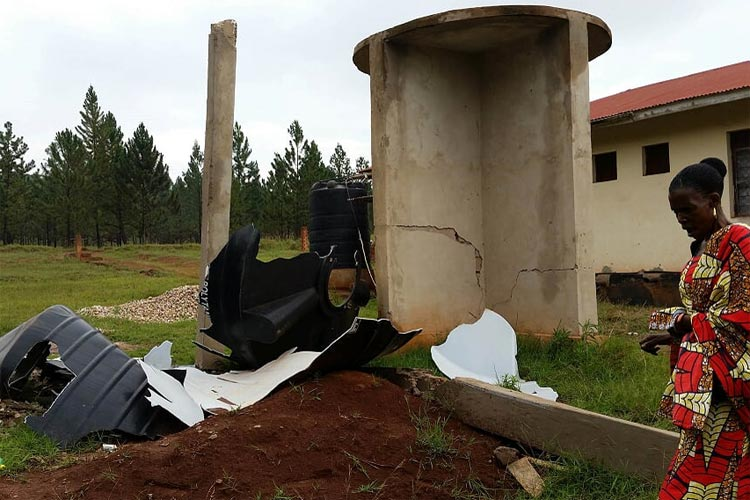 collapsed water tank at Kikukwe Village