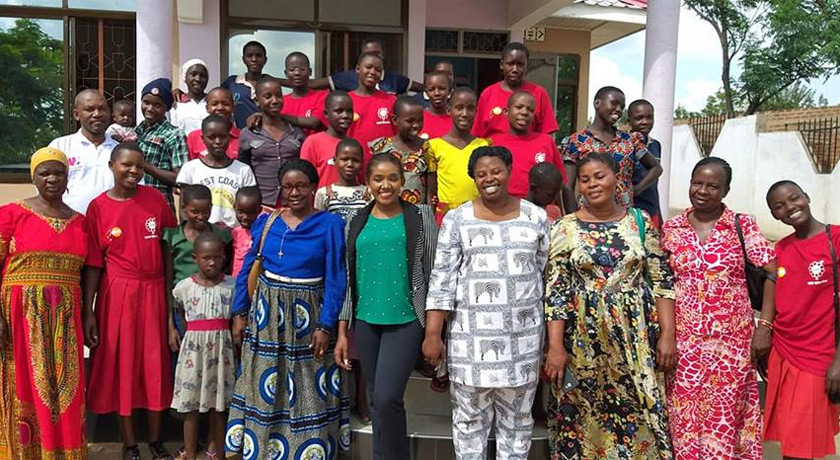 Rhobi Samwelly with girls and volunteers at Hope safe house