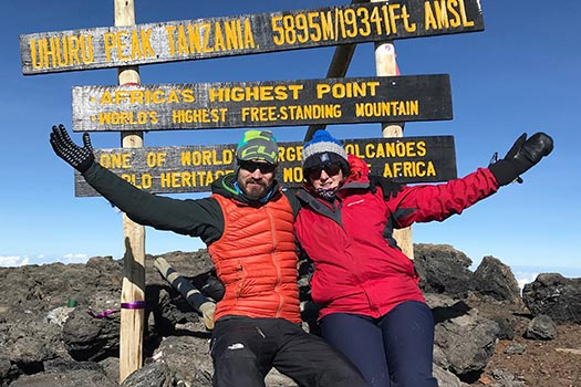 Ruth Harvey and Dan Wells at the summit of Mount Kilimanjaro