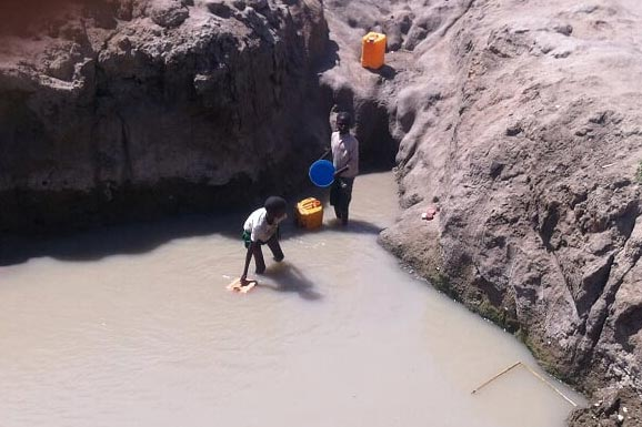 collecting water at Kilimantinde